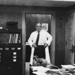 1950s in the door of his office in the Stadium in a white coat.